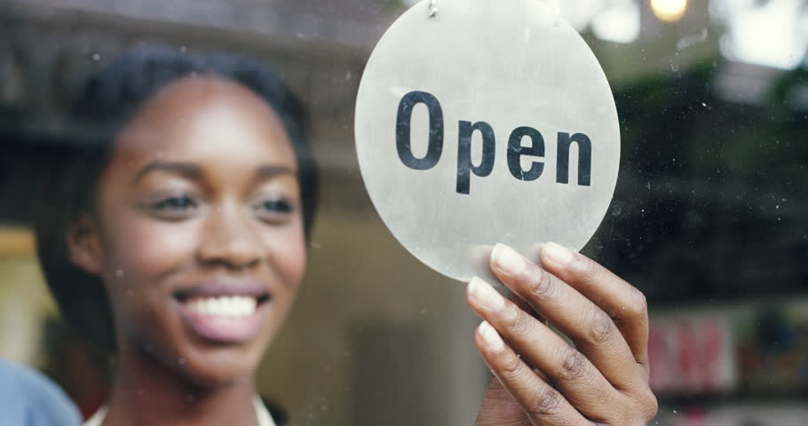 Small business owner turning over open sign | Shutterstock Video #7374598