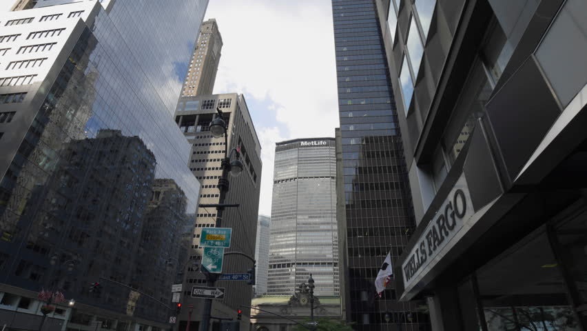 NEW YORK - AUGUST 10, 2014: MetLife Building and Grand Central Terminal in 4K in Midtown Manhattan, New York. MetLife Building is a skyscraper located at 200 Park Avenue above Grand Central Terminal. | Shutterstock HD Video #7375687