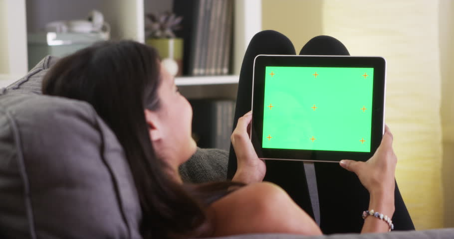 Mixed race woman laughing with tablet