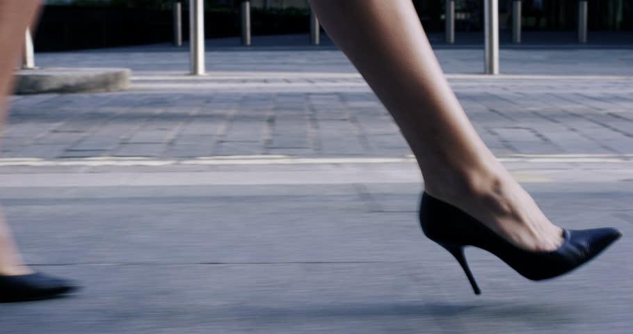 Sexy legs black high heels walking in city urban street - RED EPIC DRAGON 6K