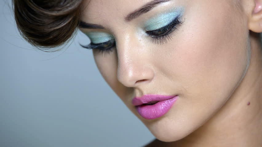 Closeup Face Of A Beautiful Girl With Blue Eye Makeup And Pink Lips Full Hd Video Footage Clip 1080