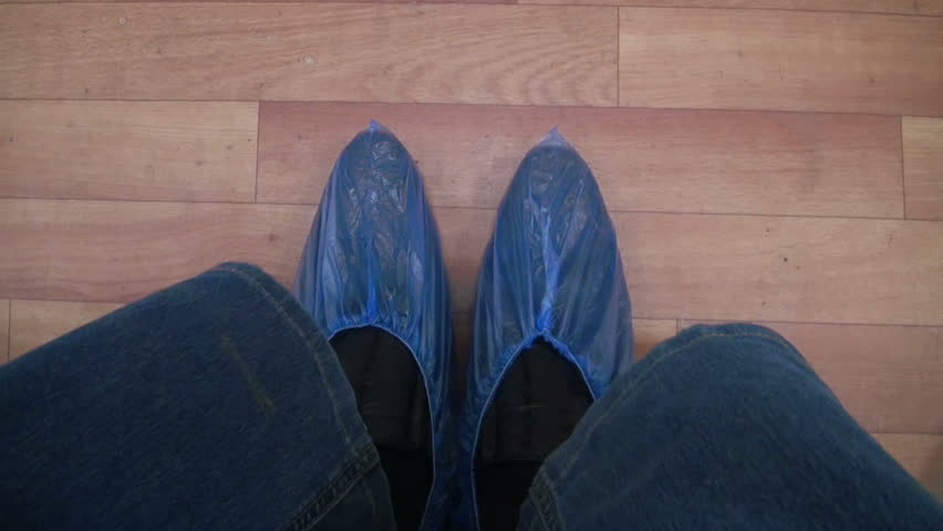 Feet in the Shoe covers. Patients on admission to the clinic. | Shutterstock HD Video #7405624