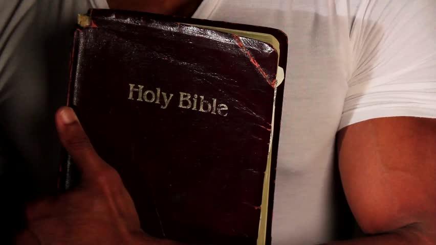 Black man holding bible | Shutterstock HD Video #7421968