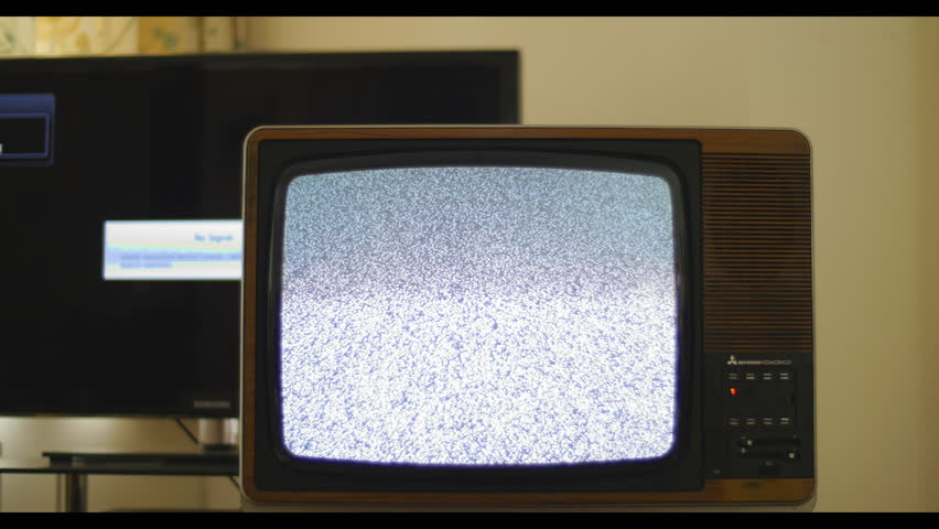 Analog and digital television interference. 76 years of television history came to an end at midnight on Wednesday 24 October 2012 when the analogue TV signal was switched off. (UK, July 2014)  | Shutterstock HD Video #7434685