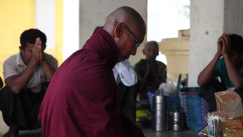 Nyaung-U, Bagan, Myanmar - March 15: Buddhist monk praying together with crowd at Shwezigon Pagoda in Nyaung U, Bagan, Myanmar (Burma). | Shutterstock HD Video #7438804
