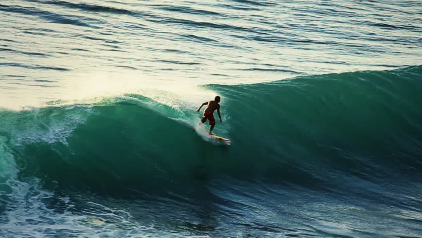 A surfer rides into the tube in super slow motion   Shutterstock HD Video #7442563