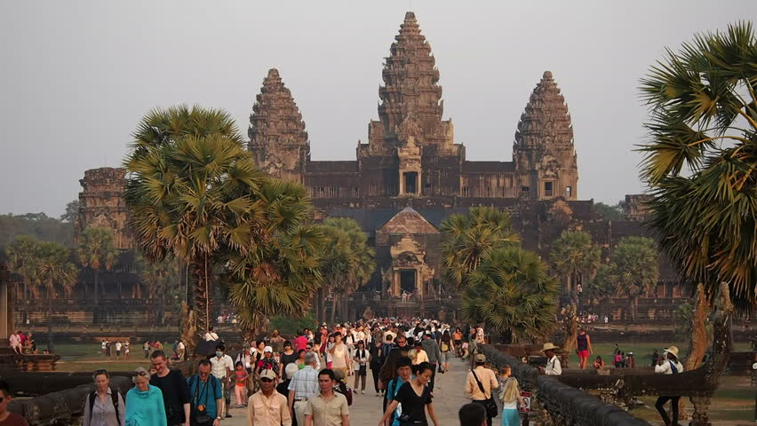 Angkor, Siem Reap, Cambodia - January 4: Tourists at the temple of Angkor Wat, the world's largest religious building, in Siem Reap, Cambodia.