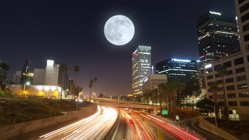Commuter freeway city traffic in downtown Los Angeles at night. 4K UHD Timelapse in motion (hyperlapse).