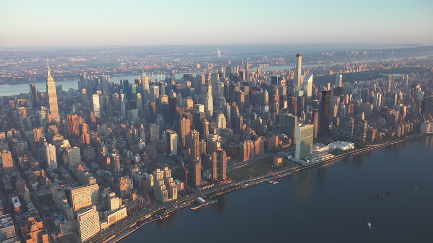 UN aerial, New York City sunrise and early morning light. Shot in 4K, dedicated plane, hard mounted open window allows a saturated, clear edge on the shot.