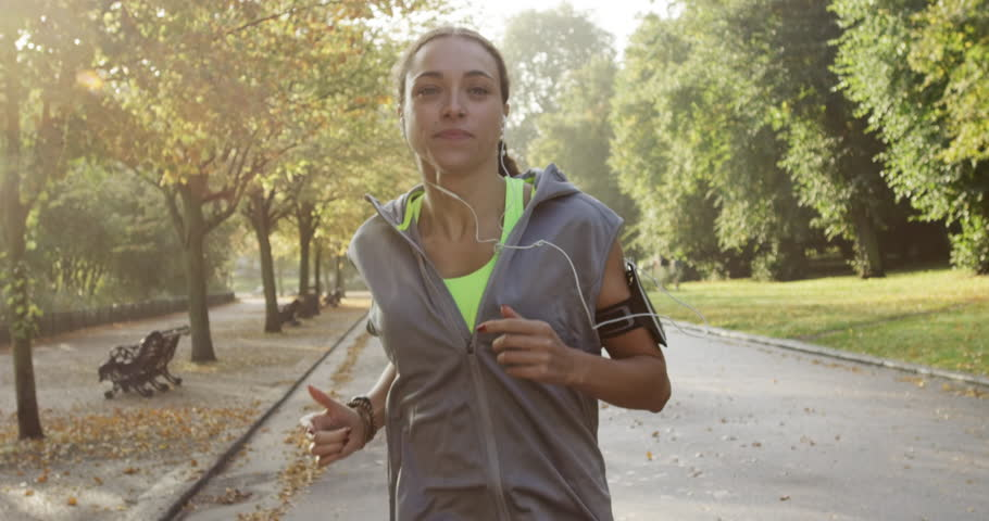 Runner woman running in park exercising outdoors fitness tracker wearable technology | Shutterstock Video #7455745