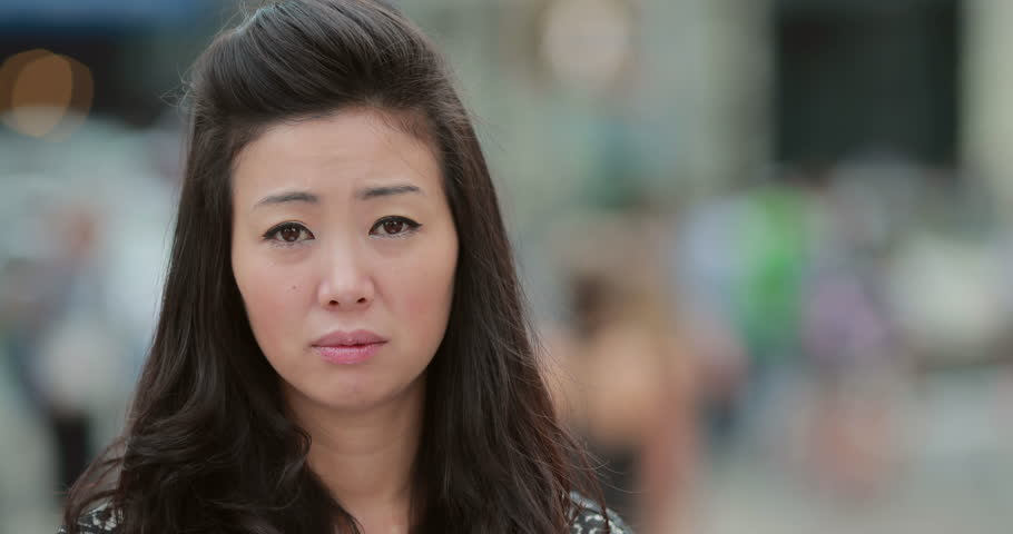 Young Asian Woman in city crying sad face portrait