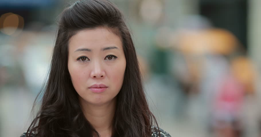 Young Asian Woman in city sad face portrait