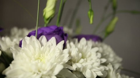 bridal bouquet of white chrysanthemums and purple lilies