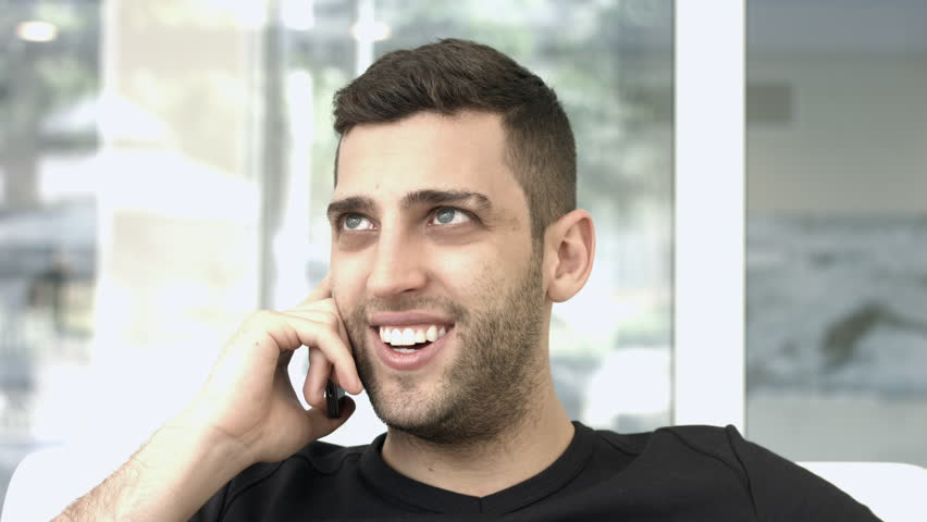 Handsome guy talking on the phone | Shutterstock HD Video #7518556