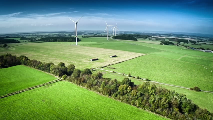 Aerial view of summer countryside with agricultural fields and wind turbines. Full HD, 1080p, 60FPS