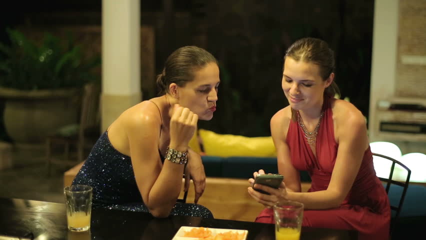 Elegant girlfriends looking at smartphone late at night  | Shutterstock HD Video #7546996