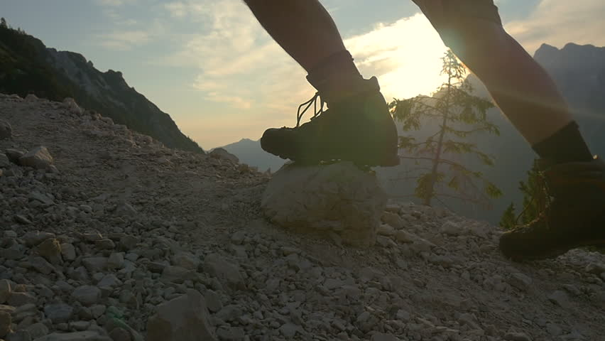 SLOW MOTION: Hiking uphill in the mountains at sunrise closeup  #7558573