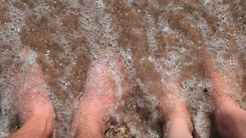 Couple in love. Male and female feet in the waves of the surf. | Shutterstock HD Video #7566763