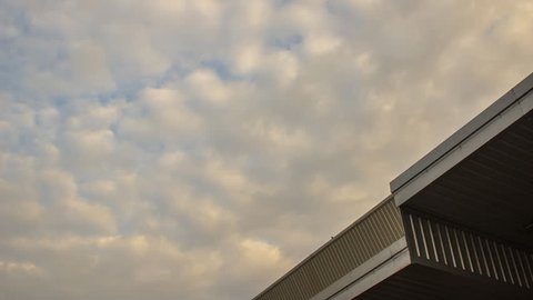 Industrial factory with blue sky. Time lapse