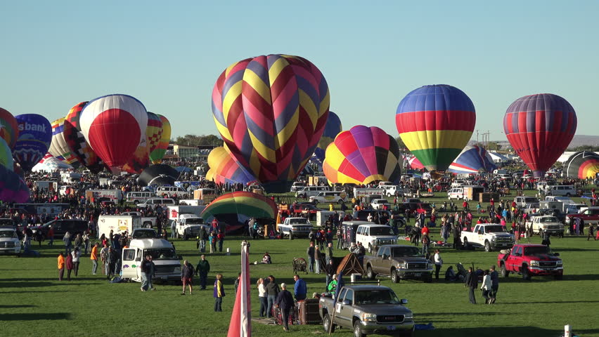 ALBUQUERQUE, NEW MEXICO - OCT 2014: Albuquerque Balloon Fiesta setting up to fly. Began in 1972 with 13 hot air balloons. Now 600 balloons from 20 different countries and is the world's largest event. | Shutterstock HD Video #7578745