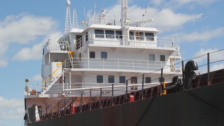 Timelapse shot of cargo ship at dock. Closeup shot of bridge. Port of Montreal, Quebec, Canada.