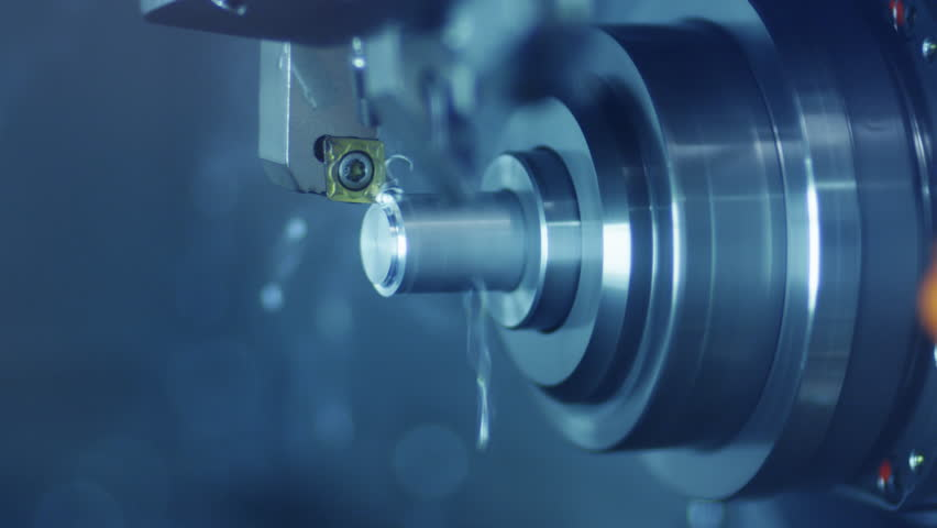 CNC Milling Machine Produces Metal Detail on Factory.Shot on RED Digital Camera in 4K, so you can easily crop, rotate and zoom. ProResHQ codec - Great for editing, color correction.