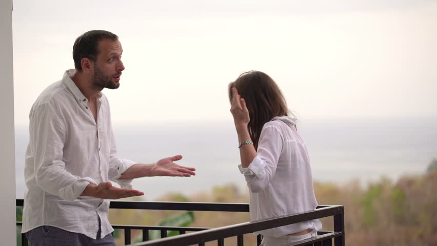Young couple fighting, arguing on terrace