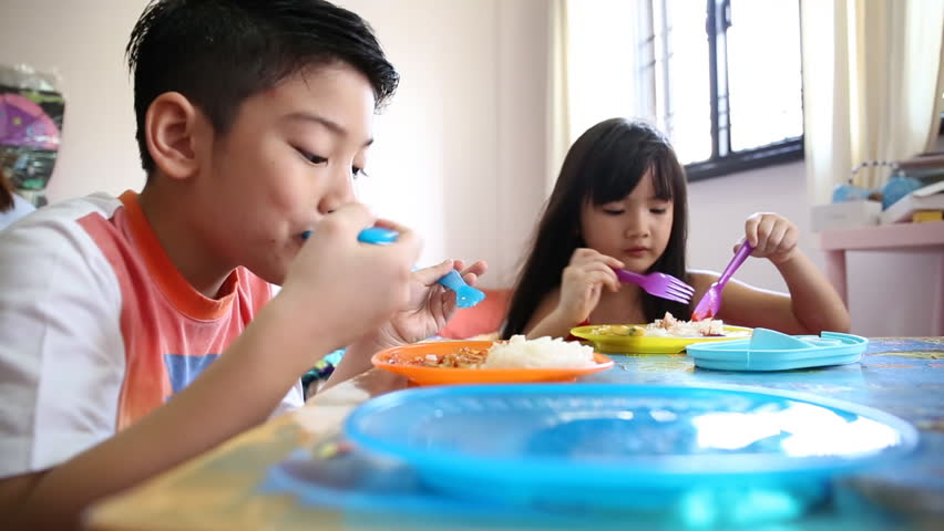 Little asian childs are eating breakfast by your salf  | Shutterstock HD Video #7612477