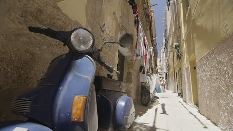 SARDINIA JUNE 2014 - Vintage scooter parked in a side street of an Italian town on a summer day. SARDINIA, ITALY 3 JUNE 2014 EDITORIAL
