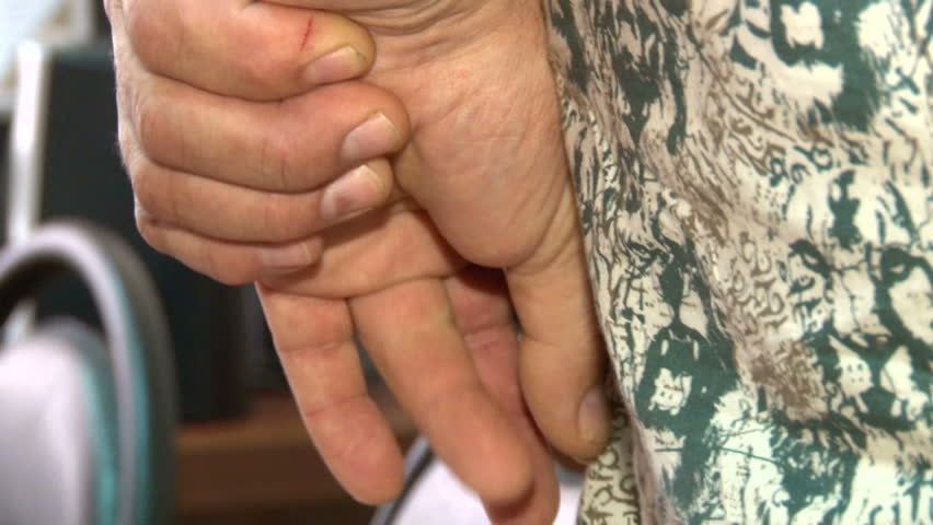 Men's hands folded behind   Shutterstock HD Video #7632274