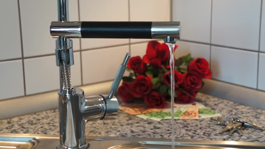 Water tap with running water and Euro Banknotes | Shutterstock HD Video #7638388