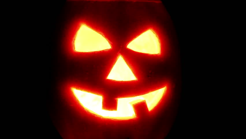 Halloween pumpkin with candle on black background | Shutterstock HD Video #7646518