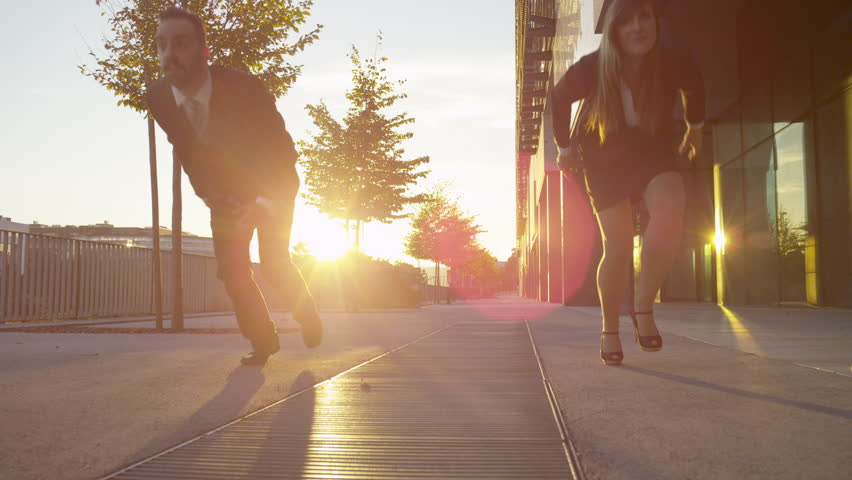 SLOW MOTION: Business people sprint down the business district   Shutterstock HD Video #7662223