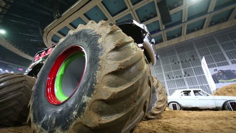 MOSCOW, RUSSIA - MARCH 23, 2013: Giant offroader rides on the sandy arena of sports complex Olympiysky at sports entertainment show Monster Mania, bottom view