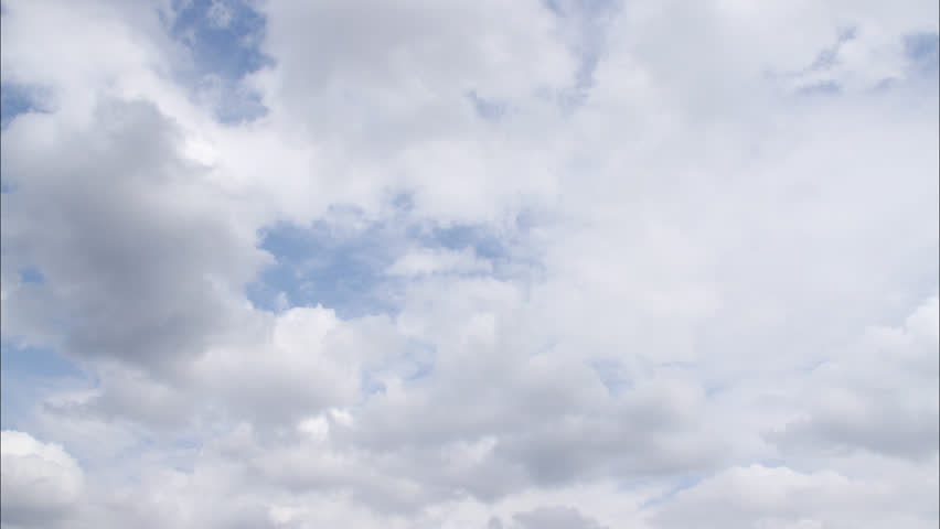 Time-lapse white puffy clouds drifting across blue sky | Shutterstock HD Video #768178