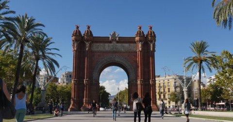 BARCELONA, CATALONIA, SPAIN - Circa October, 2014 - Tourists visit the Arc de Triomf in Barcelona.