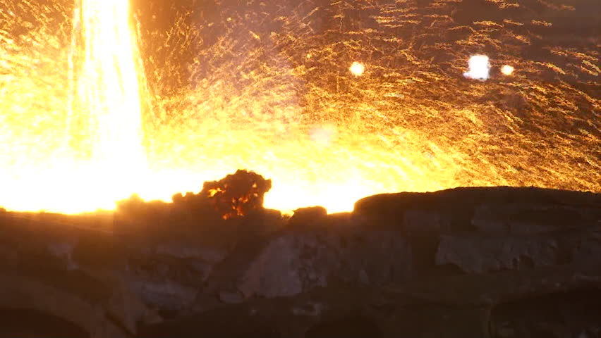 Iron and Steel Works. Pouring of molten iron. HDV to HD   Shutterstock HD Video #7705999