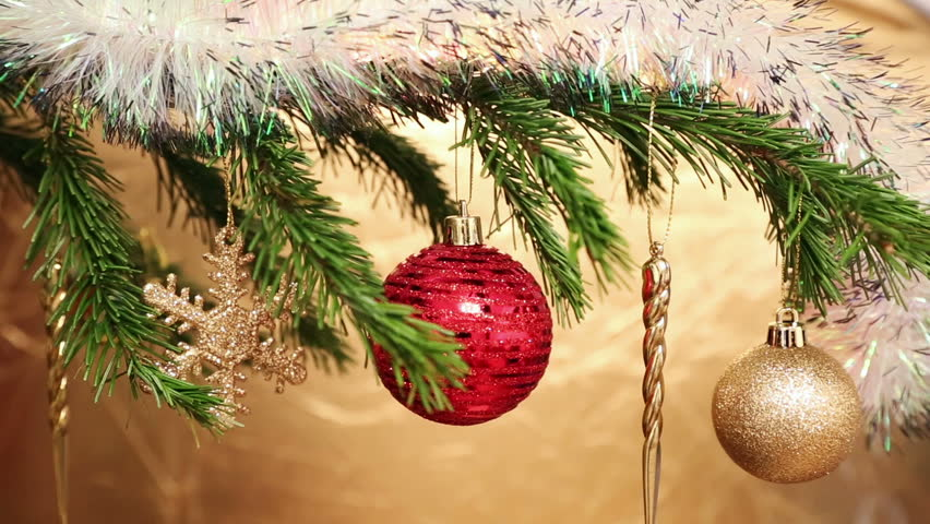 Christmas holiday toys with shiny garland on fir tree twig and wood background | Shutterstock HD Video #7712527