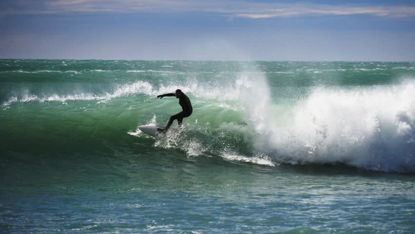 KAIKOURA, NZ - OCT 3 2014:a surfer rides a wave at a point break near kaikoura in new zealand- recorded at 1080p 60fps   Shutterstock HD Video #7750750