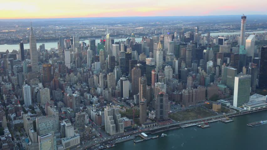 Midtown UN building aerial sunset looking West. New York City aerial sunset 4K, UHD skyline shots.