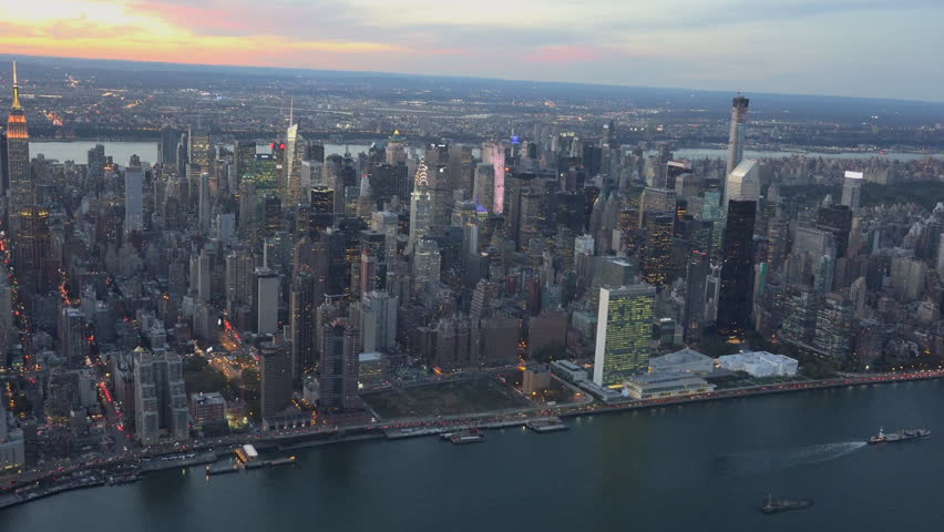 New York Sunset aerial from UN building looking West. New York City aerial sunset 4K, UHD skyline shots.
