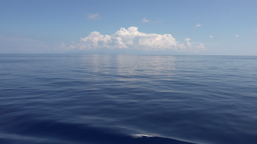 Beautiful Mediterranean Ocean blue white clouds. Beautiful Mediterranean Ocean waves with horizon in distance. Cruise ship vacation in Europe. Environmental and nature with deep blue sea.