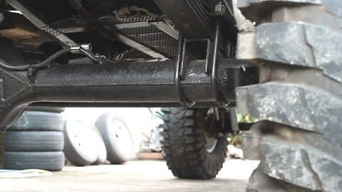 Suspension System of Truck in Dolly View. Suspension and components under the car. Parts and undercarriage of truck.