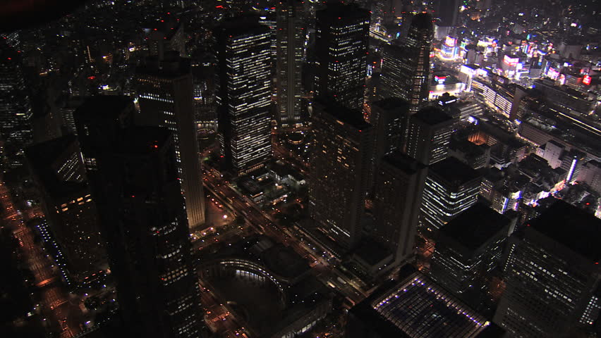 Aerial Metropolis Tokyo night illuminated city offices skyscrapers city blocks traffic structure growth transport Financial District Japan Asia | Shutterstock HD Video #7792447