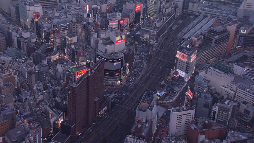 Aerial illuminated dusk view entertainment Shinjuku buildings downtown neon lights signs traffic National Rail Track Tokyo Japan | Shutterstock HD Video #7793671