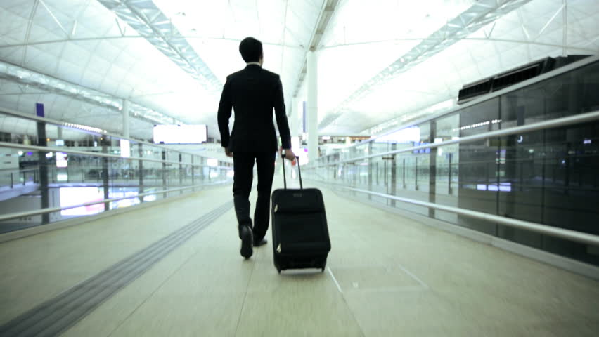 Asian Chinese young male city airport business travel passenger luggage career global executive suit meeting conference | Shutterstock HD Video #7810024
