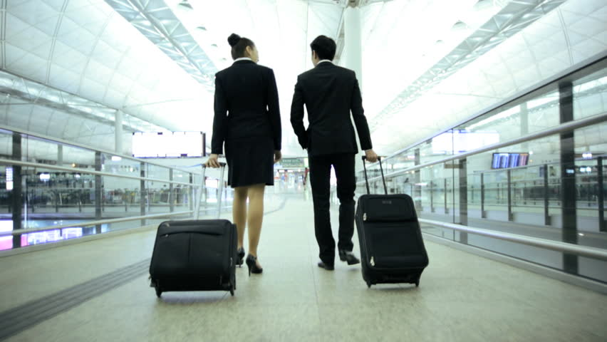 Male female Asian Chinese Caucasian financial consultants city airport travel meeting conference baggage departure destination corporate #7810030