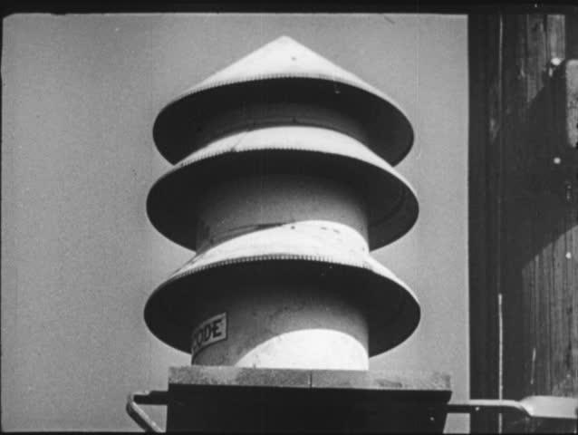 UNITED STATES- CIRCA 1950: Air raid siren, fade to middle class suburban neighborhood where atomic flash occurs,