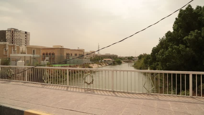 Passing Shot of Bridge over Small River Inlet in Baghdad, Iraq.