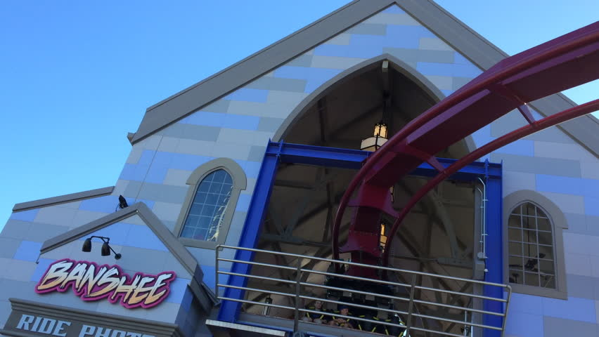 MASON, OH - OCTOBER 26: Banshee, current longest Inverted Roller Coaster, new addition to King's Island Theme park this year, leaving station with riders on October 26, 2014 in Mason, Ohio